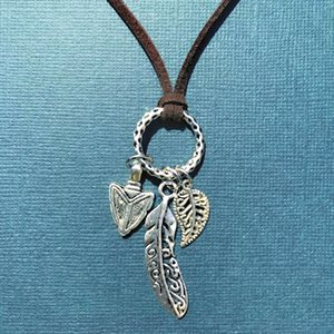 Brown Swede Necklace With Three Charms
